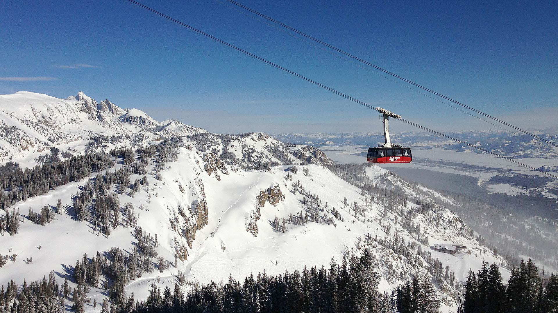 "Jackson Hole's iconic Tram, ""Big Red,"" rising 4,139 vertical feet to the ""Top of the World"" summit."